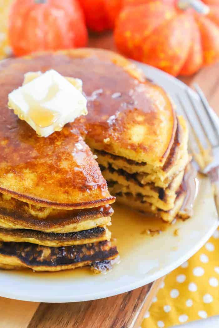 Pumpkin Pancakes on a plate with butter