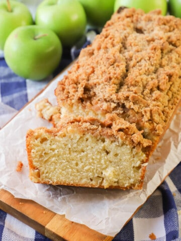 Dutch Apple Pie Bread Sliced on wooden board with apples