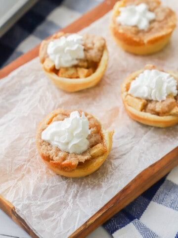 Mini Dutch Apple Pie with whipped cream topping
