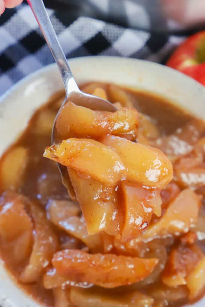 Slow Cooker Fried Apples on a spoon