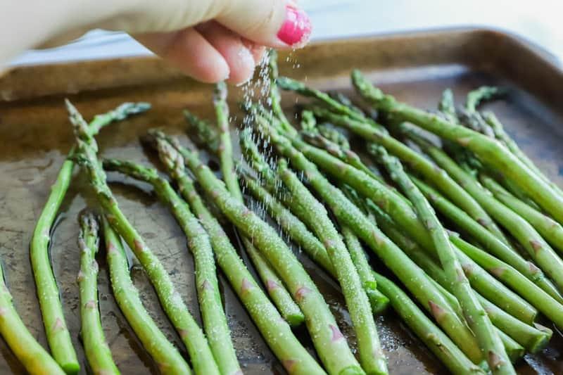 sprinkling Asparagus with salt