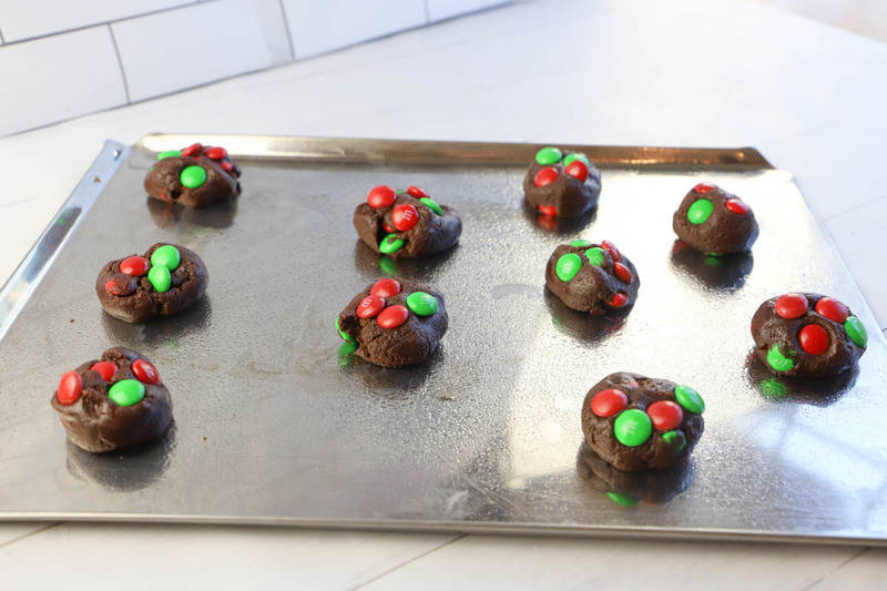 adding MM candies to the baking sheet