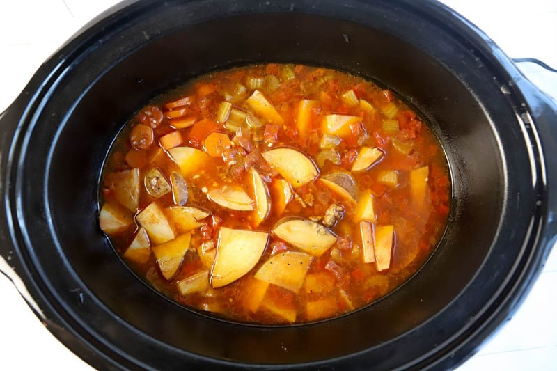 adding broth into the slow cooker
