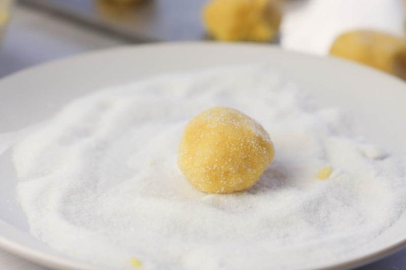 rolling dough in sugar
