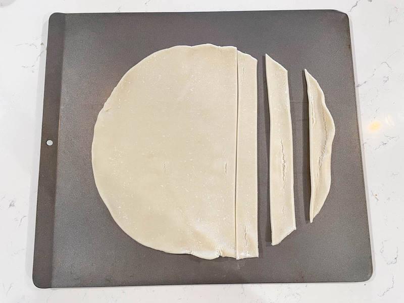sliced pie crust on baking sheet