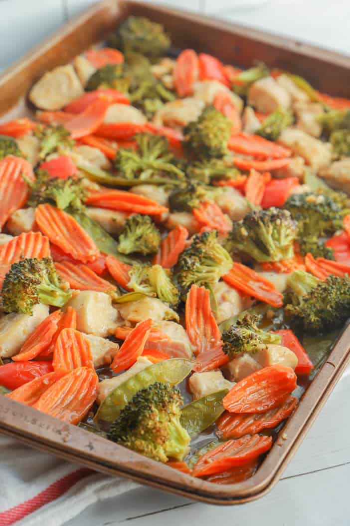 veggies and chicken cooked on the sheet pan