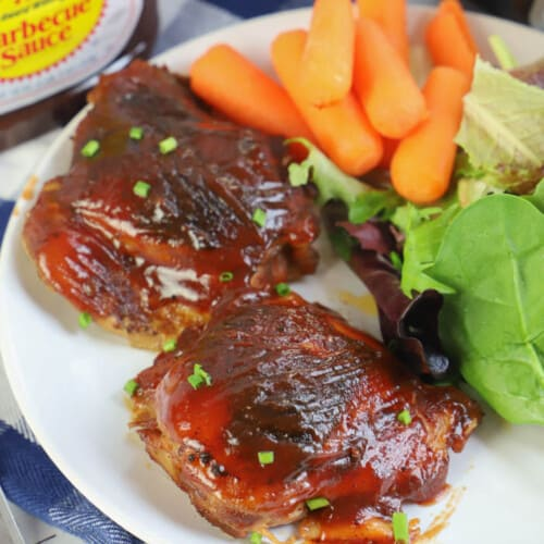 Slow Cooker BBQ Chicken Thighs in a white plate