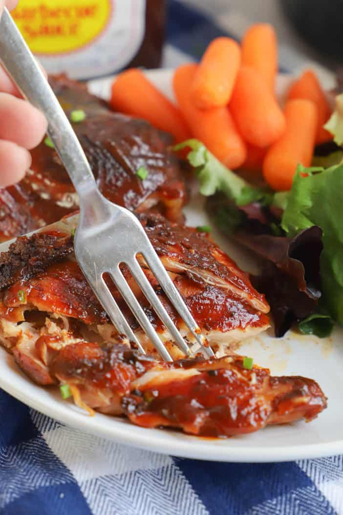 using a fork to eat Slow Cooker BBQ Chicken Thighs