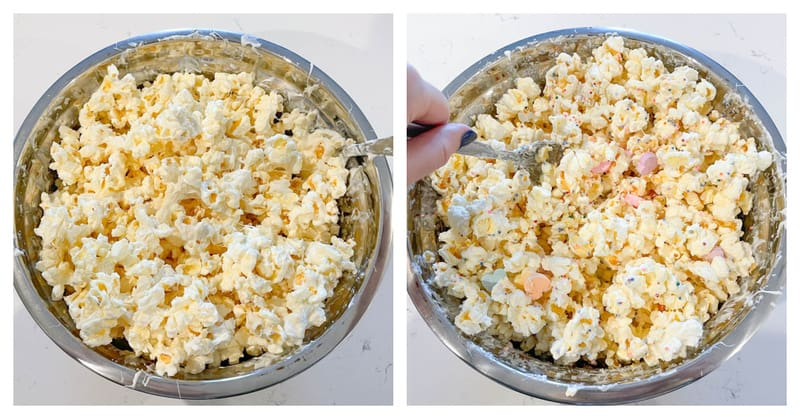 popcorn in a bowl being mixed with white chocolate and adding candies