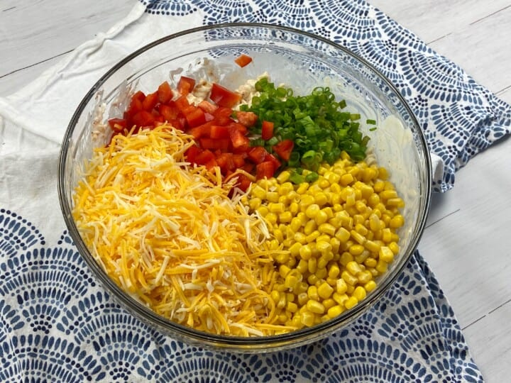 Ingredients for taco Pasta salad in a clear bowl