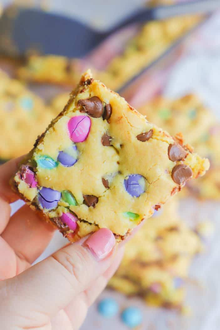 holding Easter Cake Mix Cookie Bars in my hand