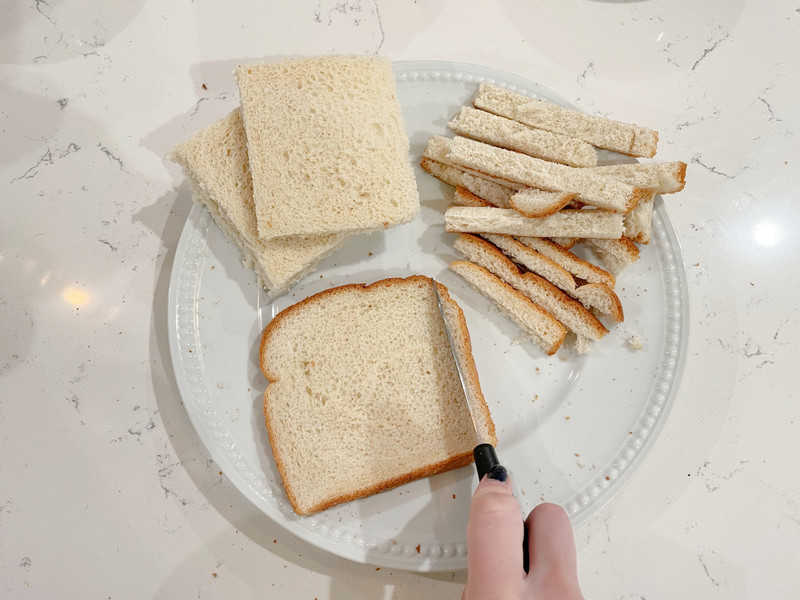 French Toast bread with crust cut off on white plate
