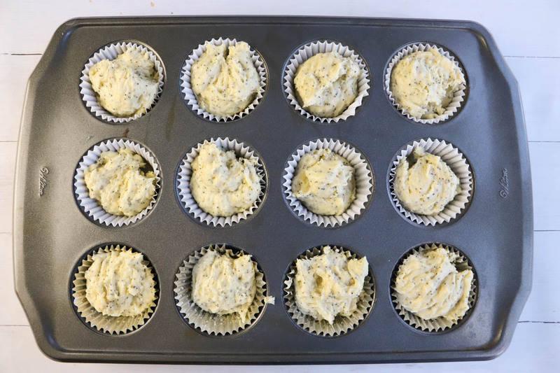 adding batter to muffin tin