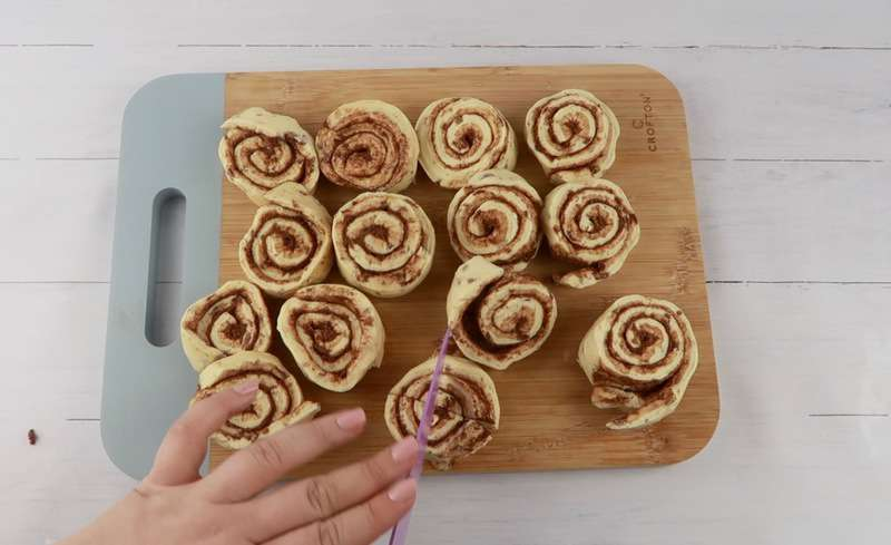 dicing cinnamon rolls for the muffins