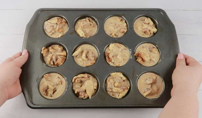 cinnamon roll muffins in muffin tin