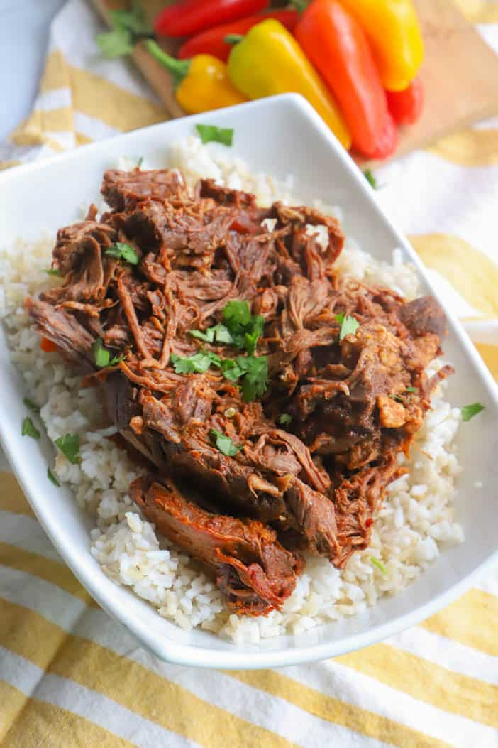 Slow Cooker Shredded Beef Tacos on a bed of rice