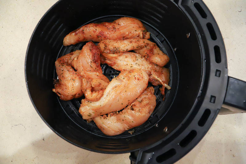 adding tenders to the air fryer before cooking