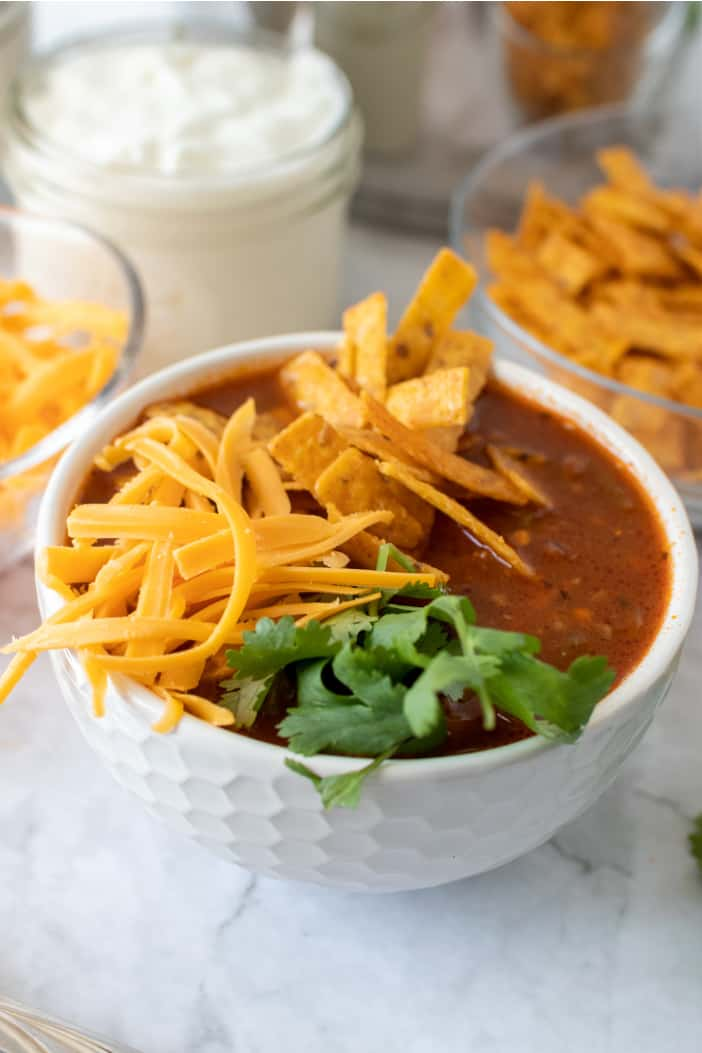 Taco Soup with shredded cheese and chips