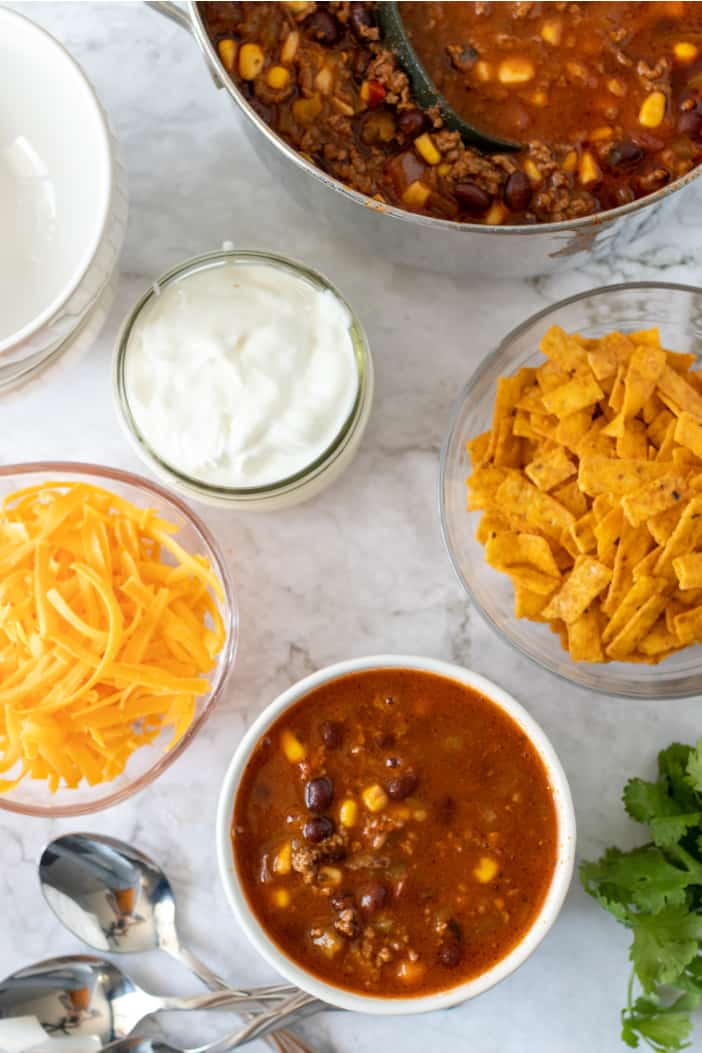 soup with sour cream and cheese in bowls