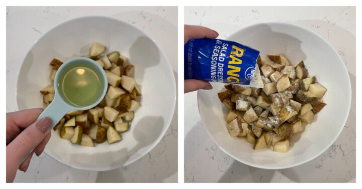 diced potatoes in white bowl while adding oil and ranch seasoning
