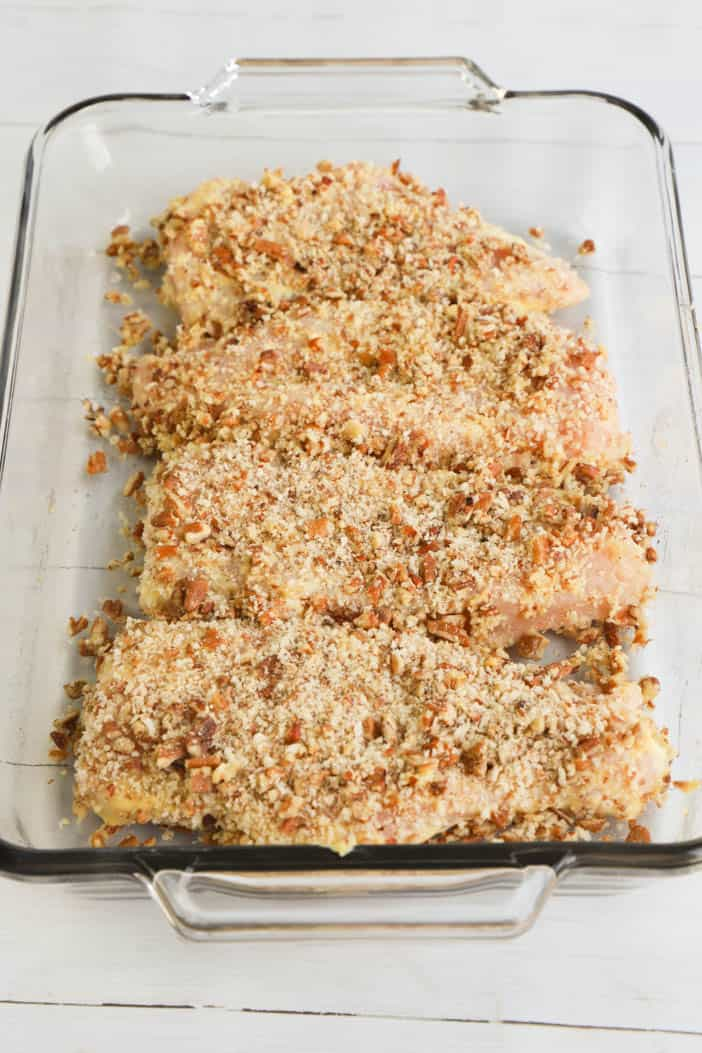 chicken with pecans in baking dish