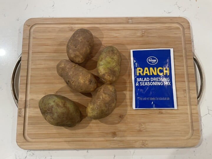 ingredients for roasted ranch potatoes on cutting board