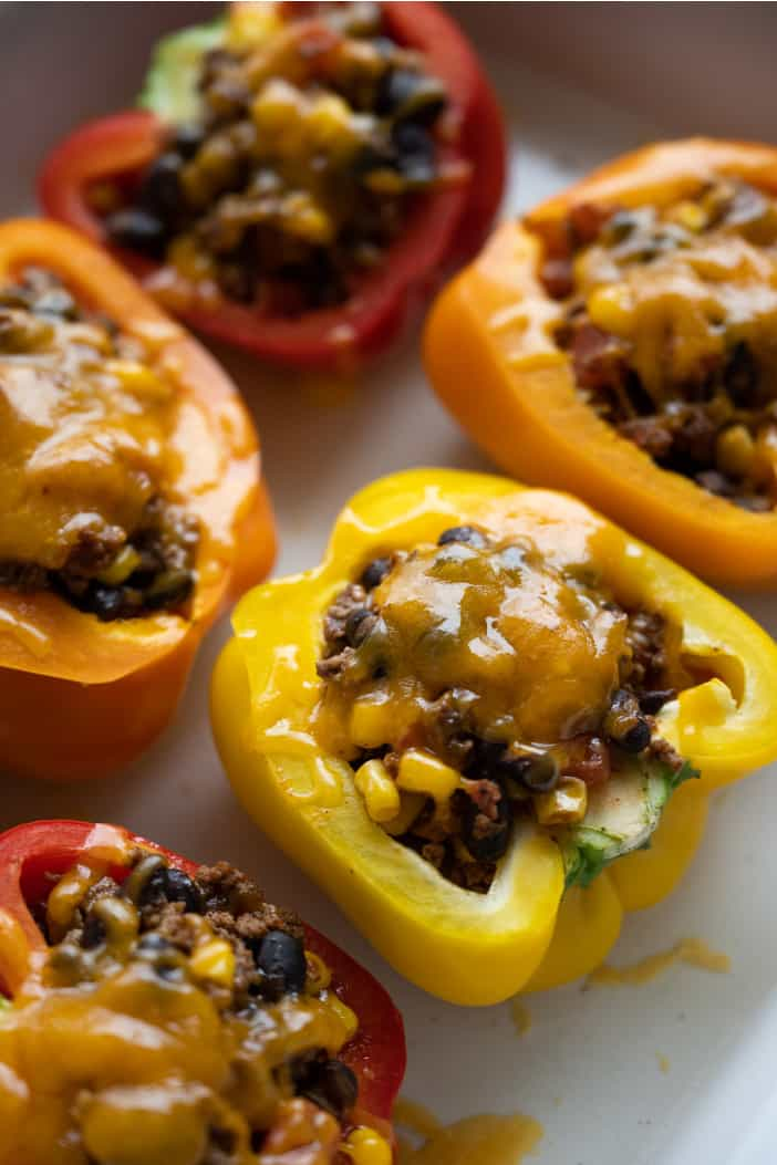 Mexican Stuffed Peppers in a white casserole dish