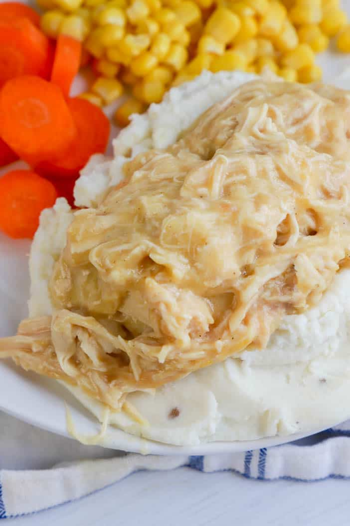 Slow Cooker Chicken and Gravy served with carrots and corn