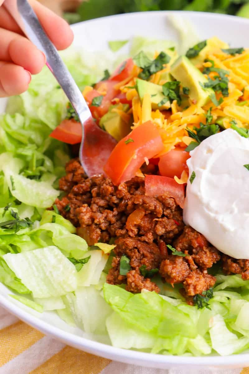 closeup of taco salad being scooped with a fork