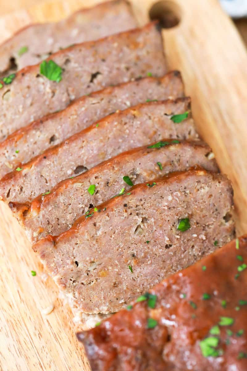 closeup of sliced meatloaf on cutting board