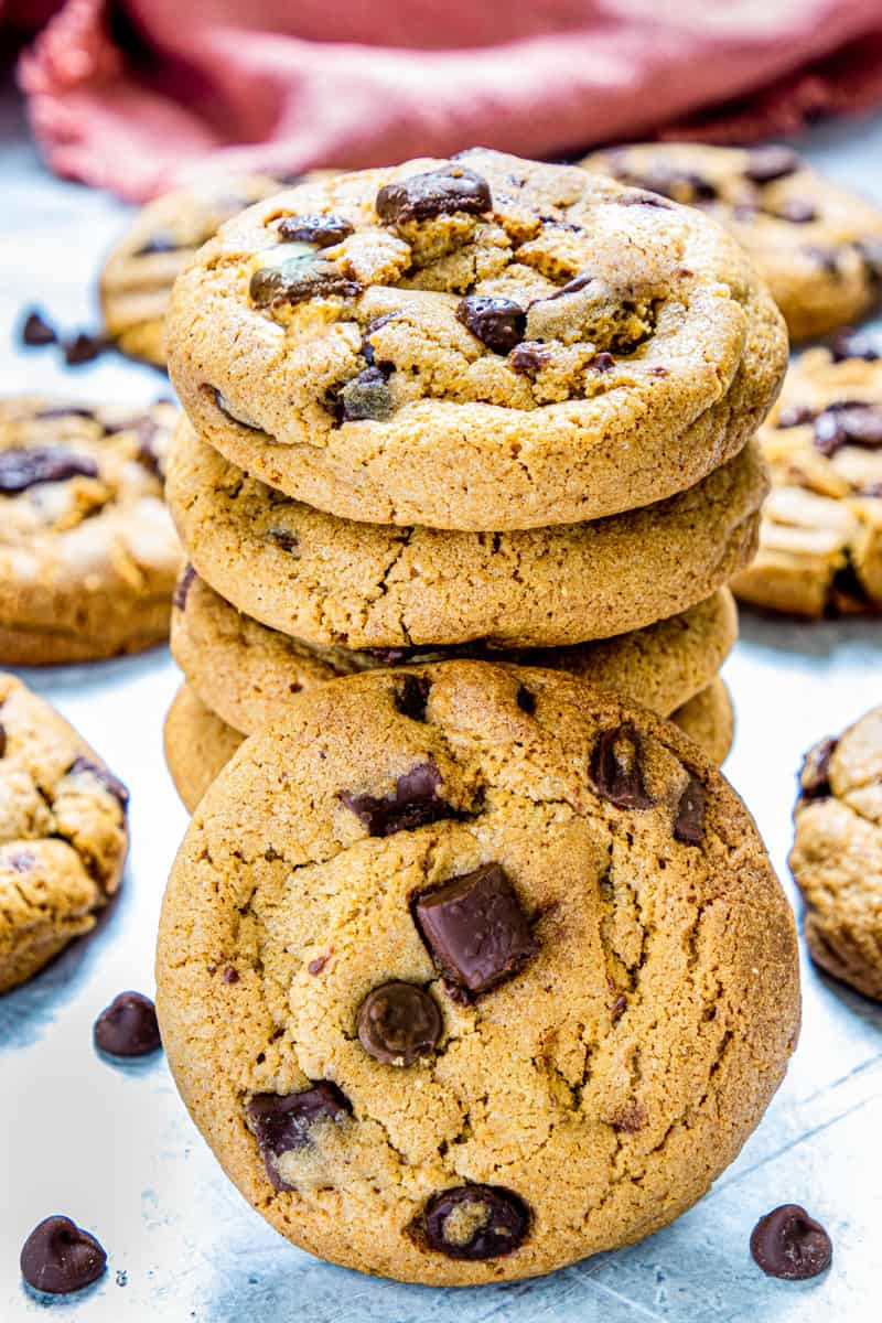 brown butter cookies stacked with one leaning on the stack