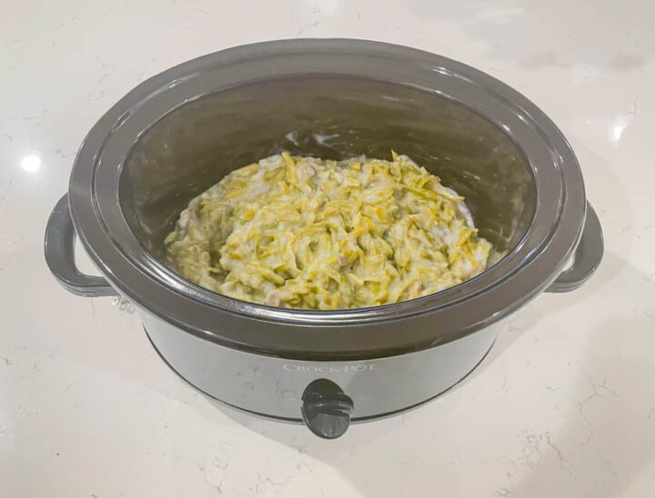 adding the green bean casserole mix to the slow cooker