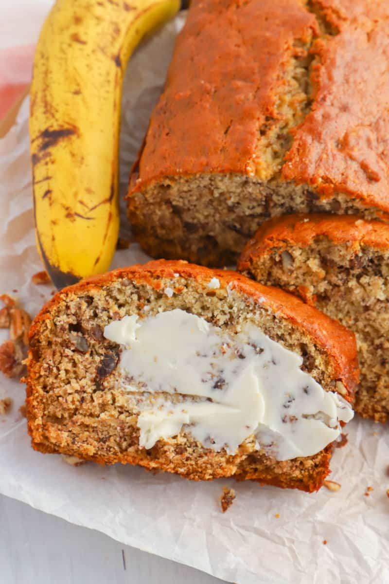 Banana Nut Bread closeup sliced with butter on the bread