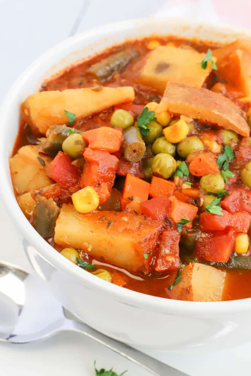 side shot photo of vegetable soup in white bowl