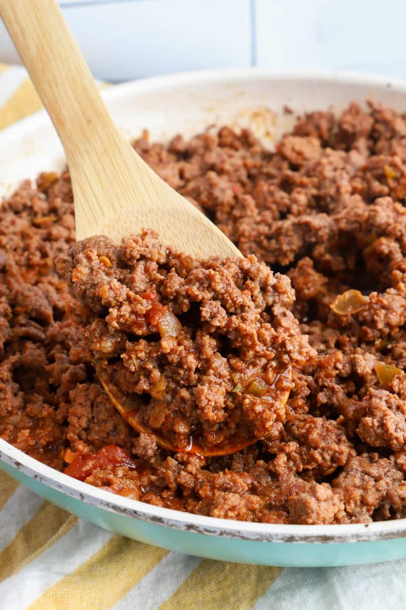 fully cooked taco meat on a wooden spoon