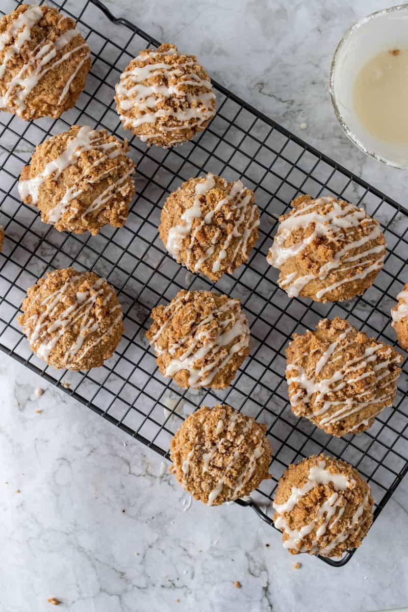 coffee cake muffins on wire rack with glaze