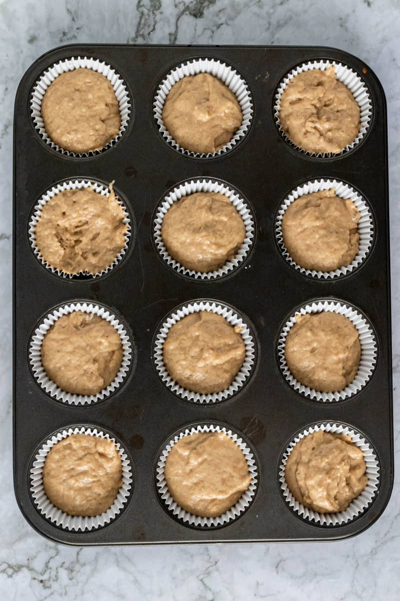 filling the muffin pan with the batter