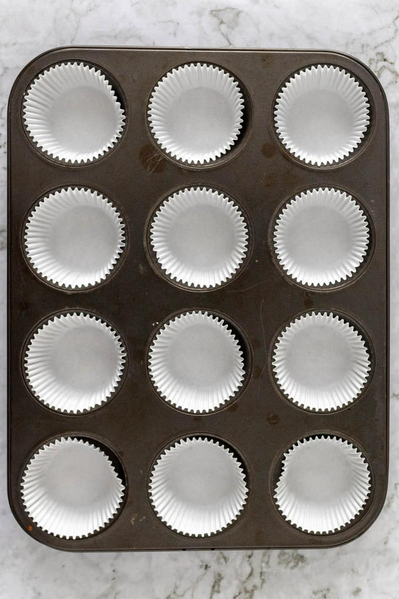 muffin baking pan lined with muffin liners