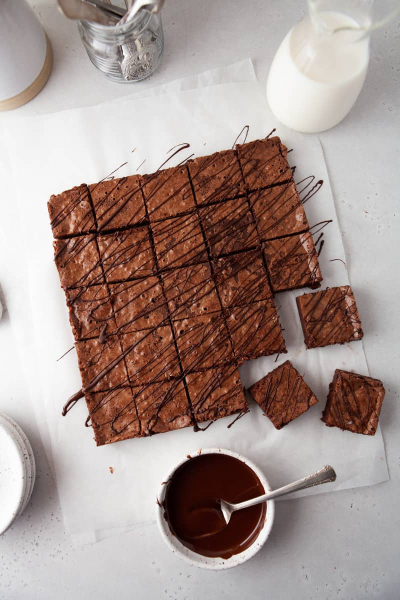 brownies sliced on parchment paper into squares