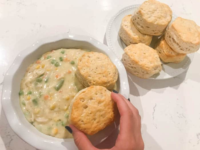 adding biscuits to the casserole dish