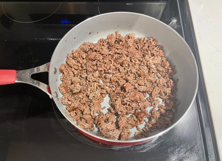 cooking ground beef in a skillet on stove top