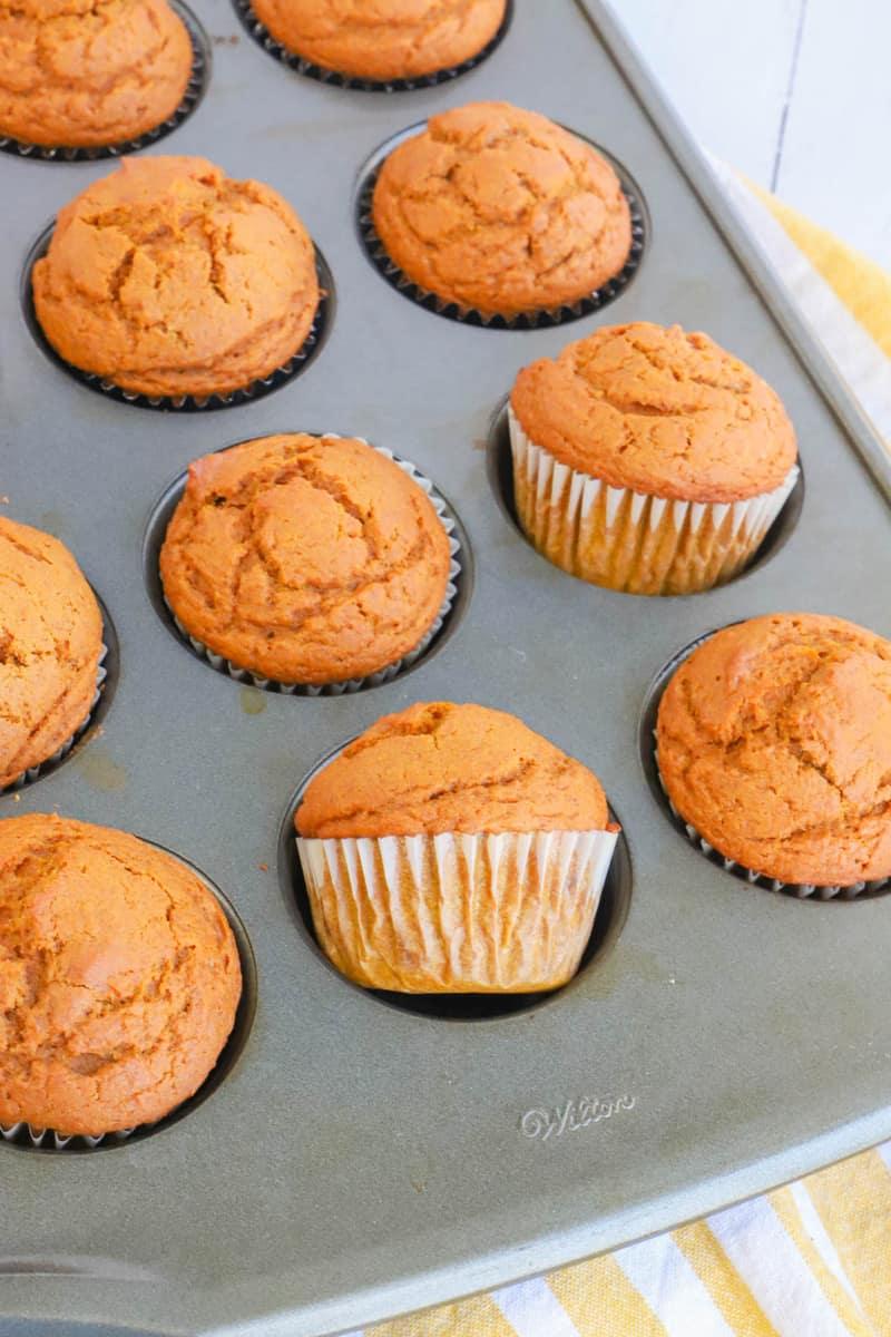 pumpkin pie muffins in a muffin pan