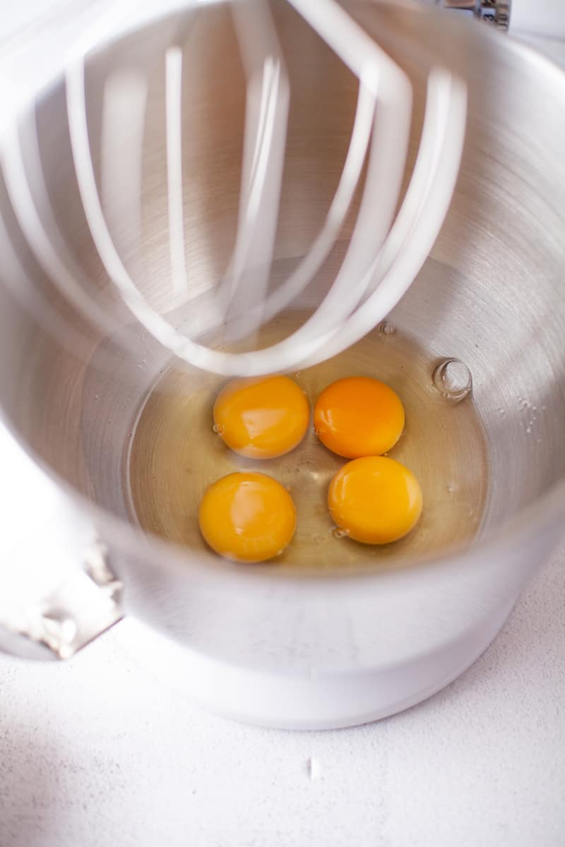 adding eggs to stand mixer