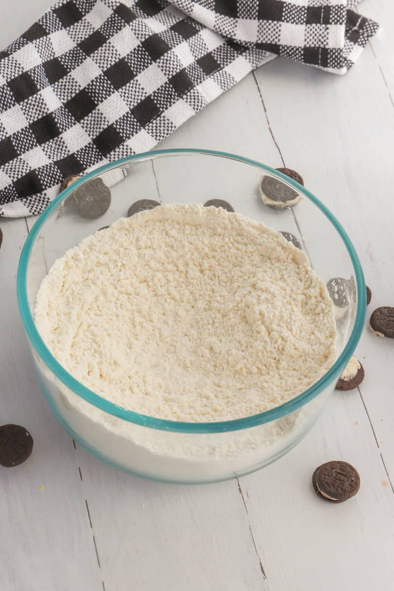 sifting flour in a glass bowl