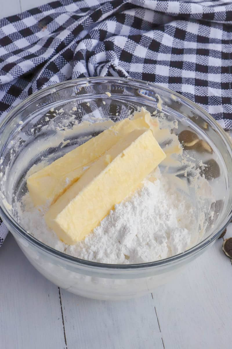 mixing sugar and butter for icing