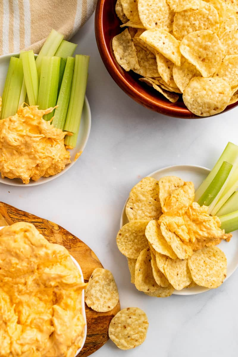 serving the buffalo chicken dip with celery and tortilla strips