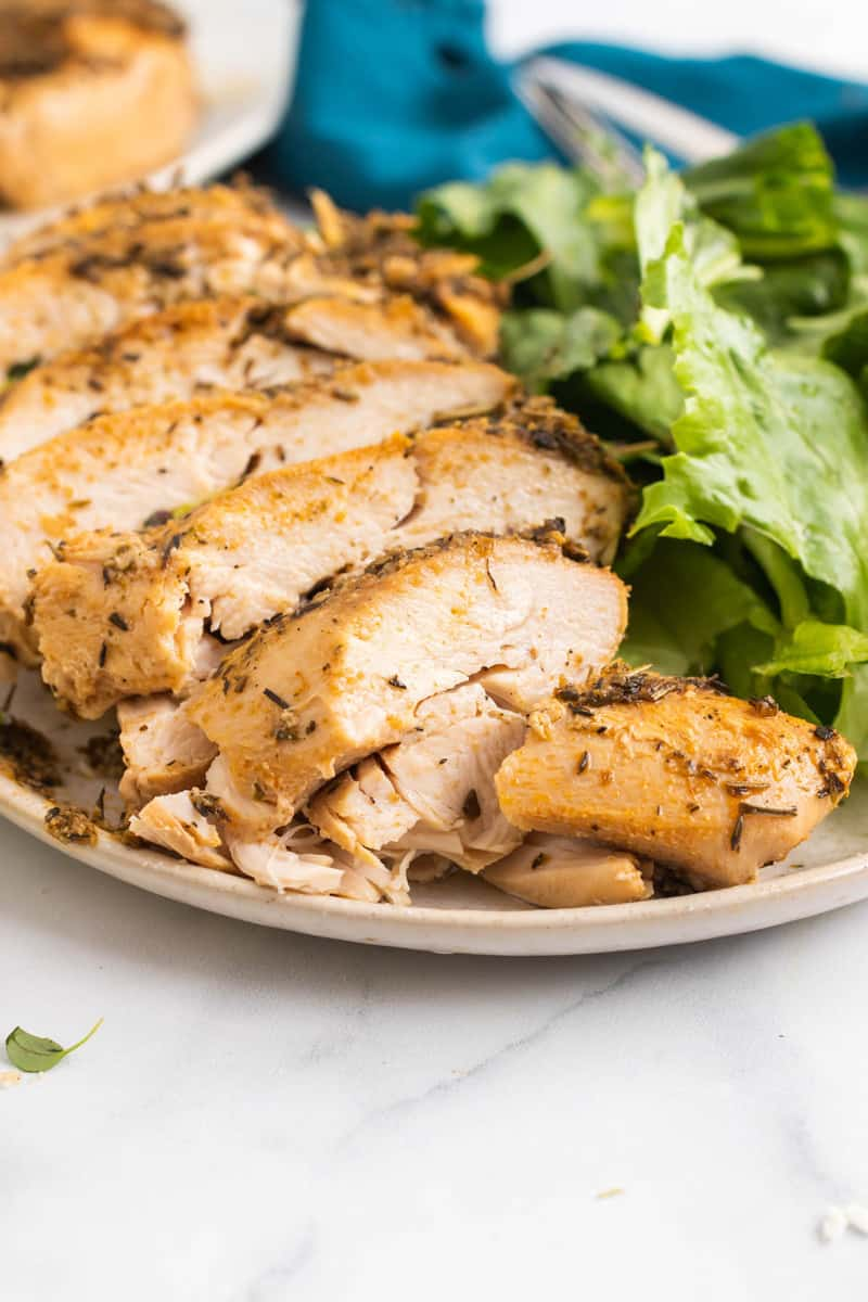 Close up picture of slow cooker turkey breast sliced on a plate