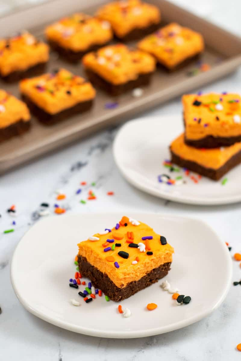 Halloween cookie bars on a white plate