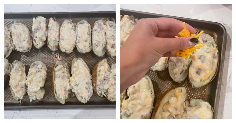 placing filled potatoes on a baking tray and topping with cheese