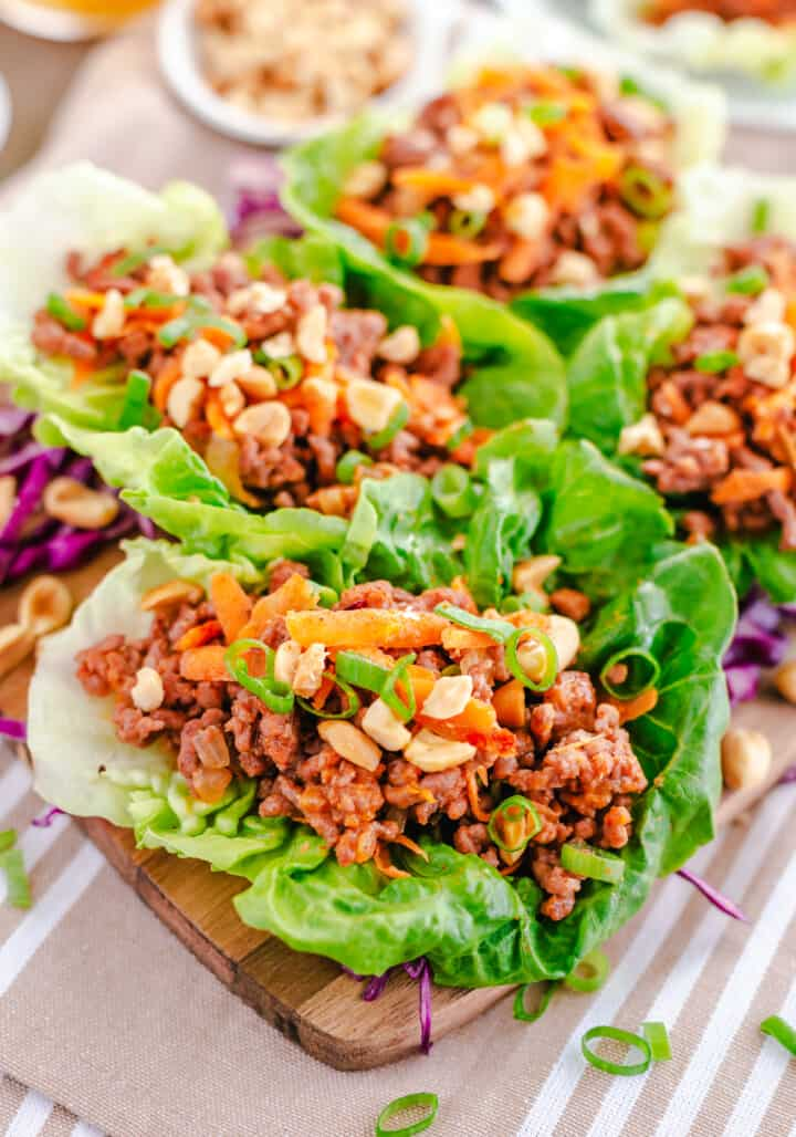 ground beef lettuce wraps on a wooden board